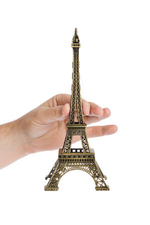 Paris Eiffel tower souvenir in hand isolated on white background
