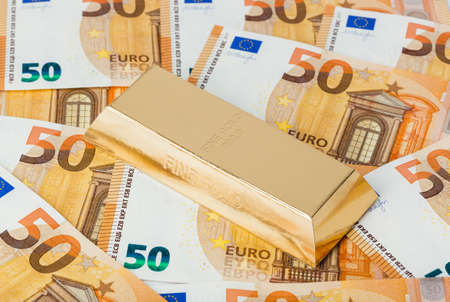 Gold and euro money - business background Stock Photo