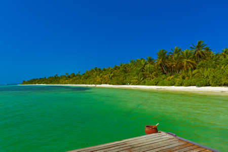 Jetty on Maldives island - nature travel background
