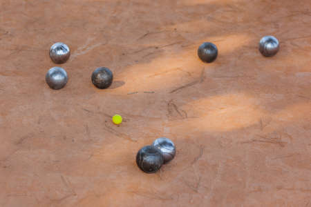 Petanque balls on the ground - sport background