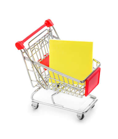 Note paper in shopping cart isolated on white background