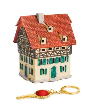 House and key isolated on white background