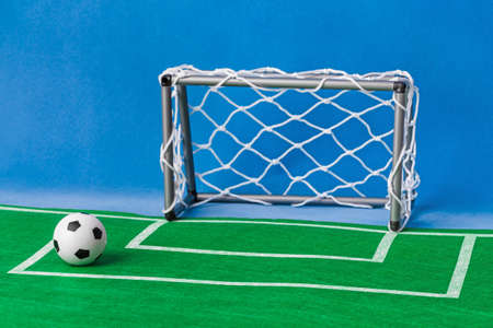 Toy football field and gate - sport background