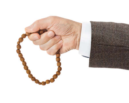 Hand with prayer beads isolated on white background Stock Photo