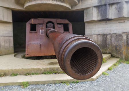 Old German cannon at Longues-Sur-Mer - Normandy France - travel and architecture background Stock Photo