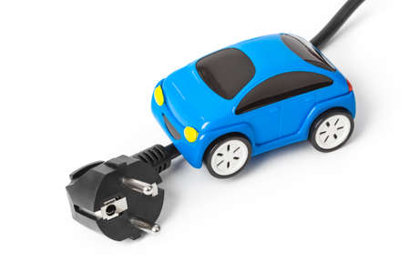 Electric plug and toy car isolated on white background