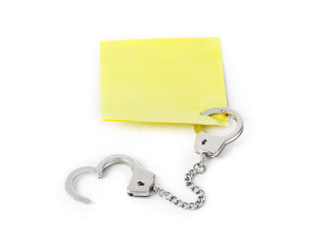 Blank paper with handcuffs isolated on white background Imagens