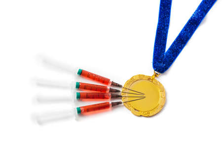 Gold medal and syringes isolated on white background