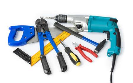 Diferentes herramientas de construcción aisladas sobre fondo blanco. Foto de archivo