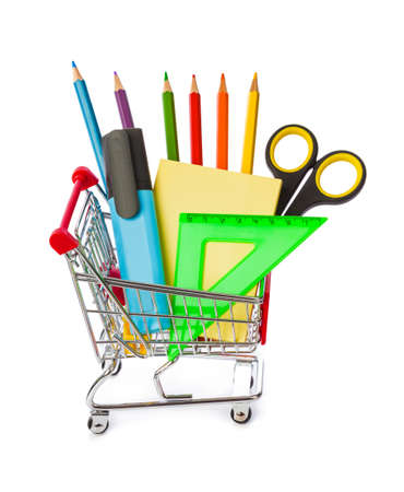 Stationery in shopping cart isolated on white background
