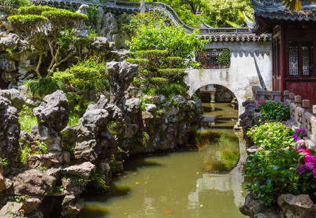 Yuyuan garden (Garden of Happiness) in center of Shanghai China - travel and architecture background