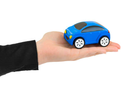 Hand and toy car isolated on white background Standard-Bild - 122107948