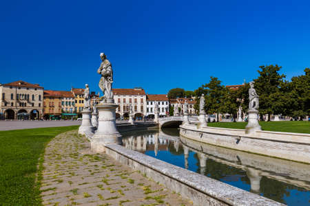 Canal with statues on prato della Valle in Padova Italy - architecture background