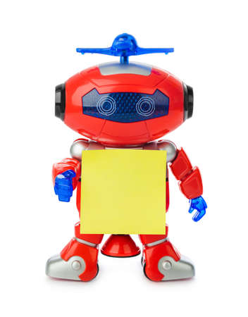 Toy robot with blank paper isolated on white background