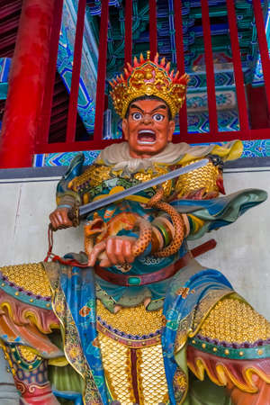 Statue in famous Shaolin Buddhist monastery - China - travel and architecture background