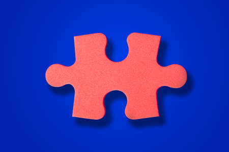 Piece of puzzle on blue background