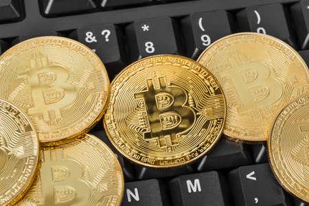Bitcoins and computer - business technology background Standard-Bild - 122028615