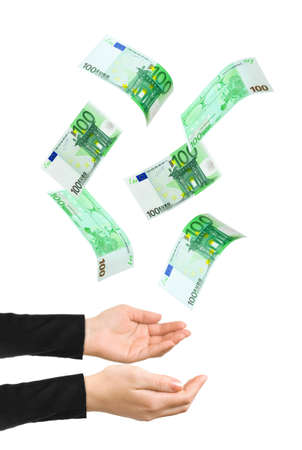 Hands and falling money isolated on white background Reklamní fotografie