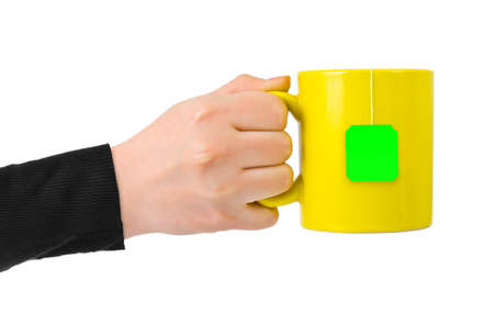 Hand with cup of tea cup of tea isolated on white background Standard-Bild - 122108302