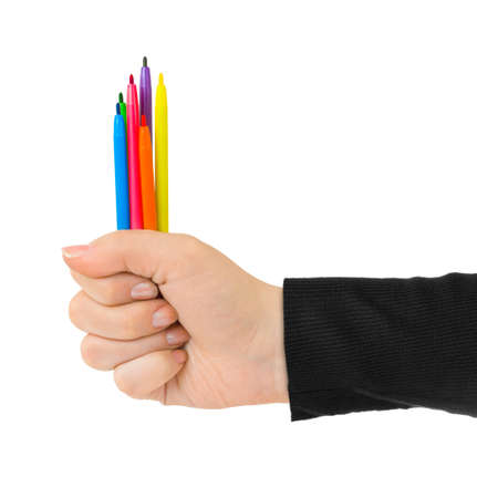 Hand with multicolored pens isolated on white background