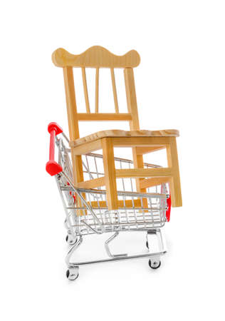 Chair in shopping cart isolated on white background