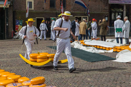 Alkmaar, Netherlands - April 28, 2017: Cheese carriers at traditional cheese market. Редакционное