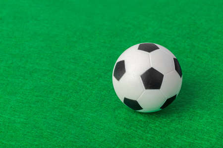 Soccer ball on football field - sport background