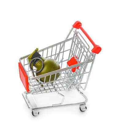 Hand grenade in shopping cart isolated on white background Фото со стока
