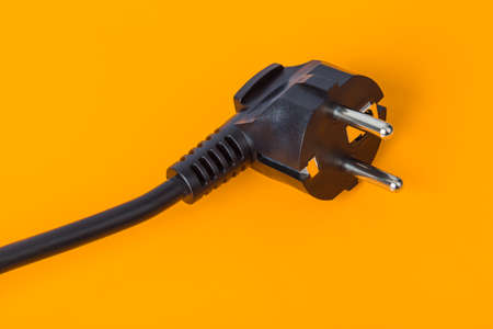 Electrical plug - orange background
