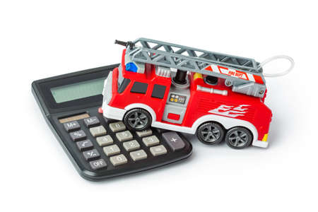 Calculator and toy fire truck isolated on white background