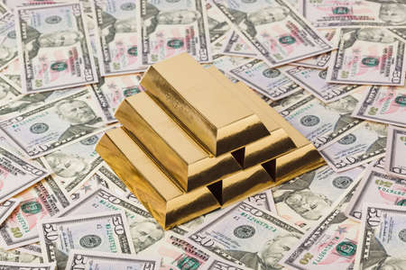 Gold bars and money - business background Фото со стока