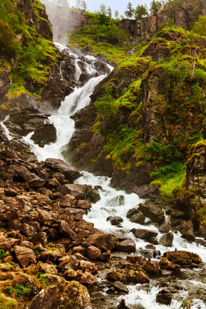 Famous waterfall Laatefossen in Hardanger Norway - nature and travel background Фото со стока