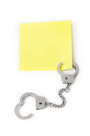 Blank paper with handcuffs isolated on white background 写真素材