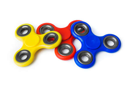Multicolored spinners isolated on white background 写真素材