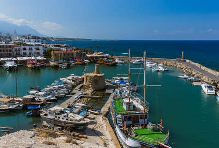 Kyrenia (Girne), Northern Cyprus - October 03, 2019: Old harbour of Kyrenia (Girne) and medieval fortress.