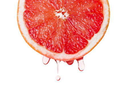 Ripe grapefruit and drops of juice isolated on white background Reklamní fotografie