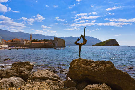 Dancer statue and Old Town in Budva Montenegro - architecture travel background