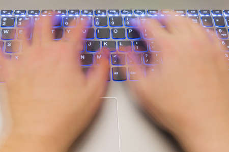 Notebook and motion blur hands - technology concept background