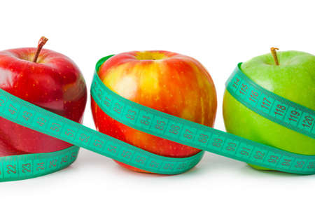 Apples and measuring tape isolated on white background 写真素材