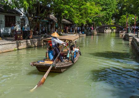 Shanghai, China - May 23, 2018: Boat cruise on the canal in Zhujiajiao water town. 報道画像