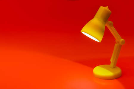 Desk lamp on red background