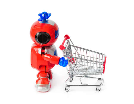 Toy robot and shopping cart isolated on white background