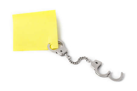 Blank paper with handcuffs isolated on white background Zdjęcie Seryjne