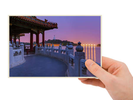Hand and Sunset In the Beihai Park - Beijing China (my photo) isolated on white background