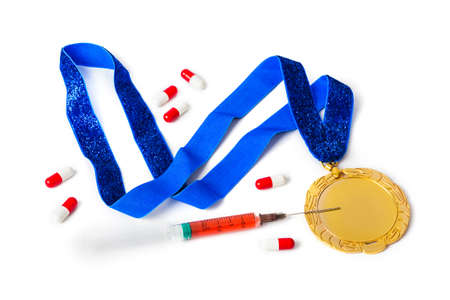 Gold medal with syringe and pills isolated on white background