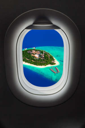 Tropical island at Maldives in airplane window - travel background Zdjęcie Seryjne