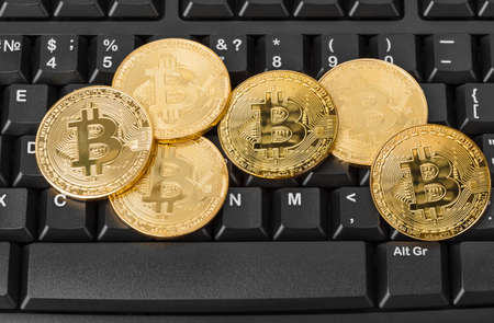 Bitcoins and computer - business technology background 写真素材