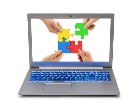 Hands and puzzle in computer - isolated on white background