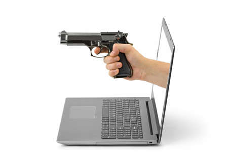 Hand with gun and notebook isolated on white background