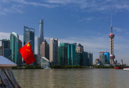 Shanghai, China - May 23, 2018: Chinese flag and modern Pudong skyline in Shanghai, China. Publikacyjne